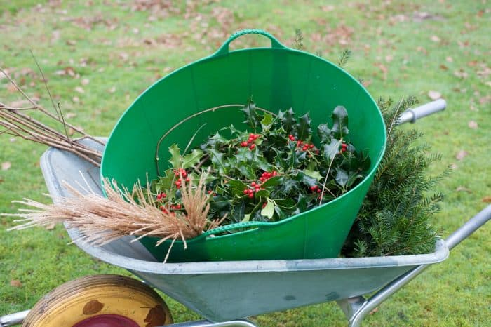 Collecting all of the foliage and materials needed in a wheelbarrow.