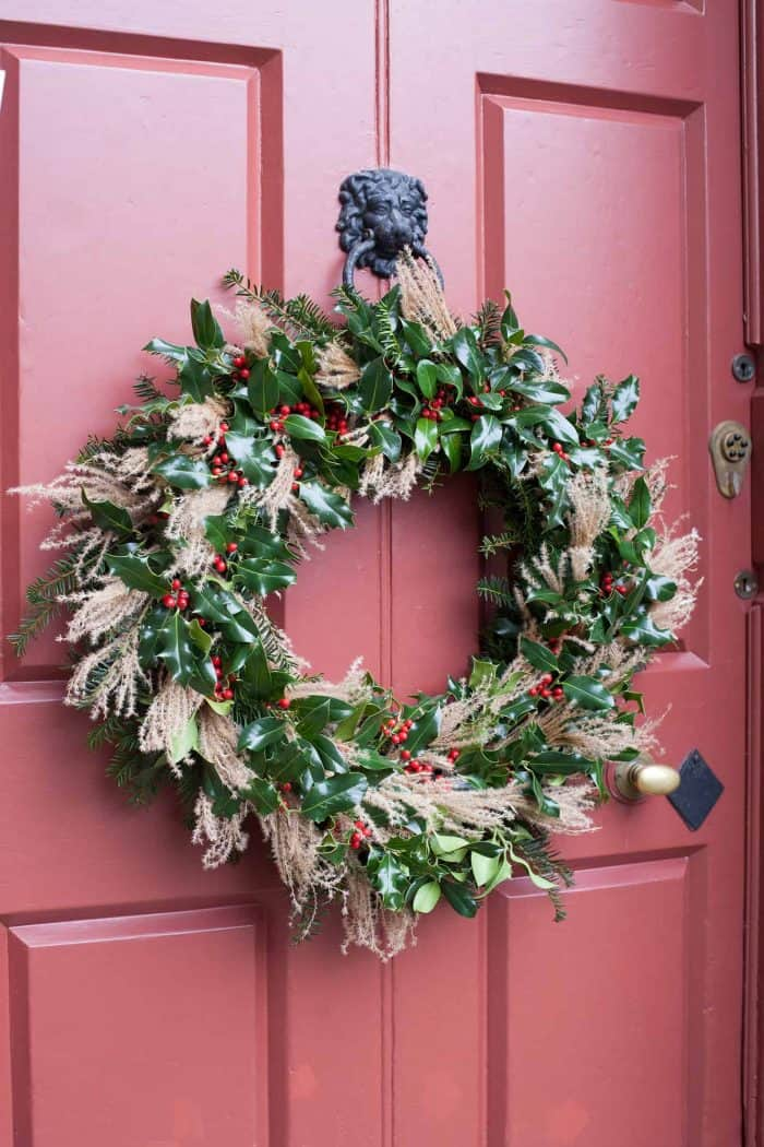 The finished Christmas Wreath hung on a door