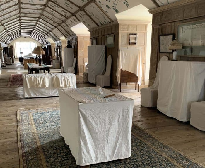 Dustsheets being put on all of the furniture by Parham's Housekeeping