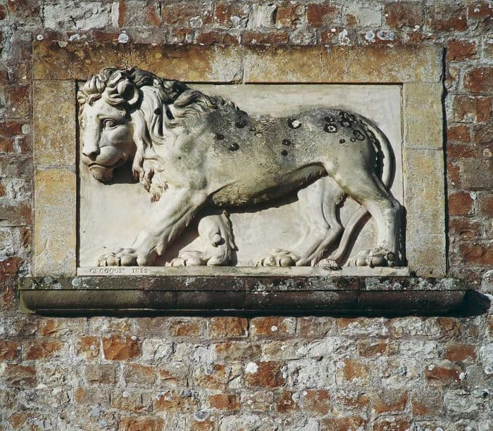 A lion carved in to Coad stone on the Parham water tower