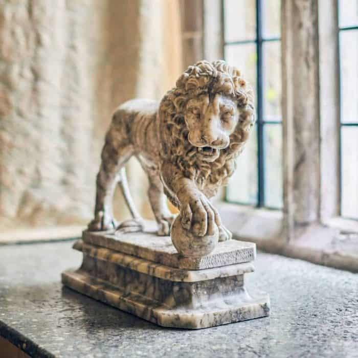 Lion sculpture on windowsill at Parham House